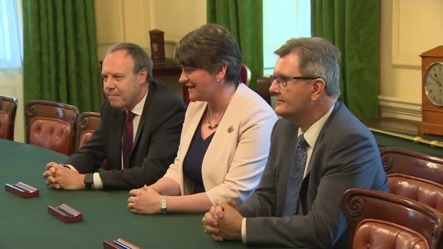 conservative party agrees deal with the dup / theresa may presents post-brexit offer to eu citizens; england: london: downing street: ext theresa may... - dup stock-videos und b-roll-filmmaterial