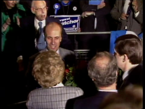 conservative party chairman norman tebbit gives prime minister margaret thatcher bouquet as she arrives at conservative party hq with third general... - elezioni generali video stock e b–roll