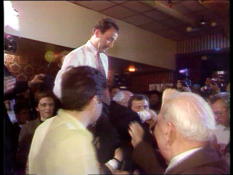 vídeos y material grabado en eventos de stock de closing the gap; wales: monmouth int labour candidate winner huw edwards on peoples shoulders after winning by-election itn tx 17.5.91 - huw edwards