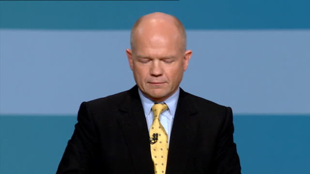 conservative party conference 2010: possible state benefit changes; shots of women in saris dancing to indian music on stage william hague mp speech... - politics and government点の映像素材/bロール