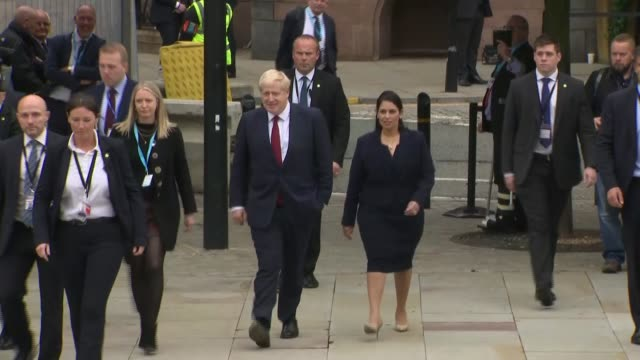 conservative party conference 2019: boris johnson and priti patel arrive for second day; england: manchester: ext boris johnson mp and priti patel mp... - boris johnson stock videos & royalty-free footage