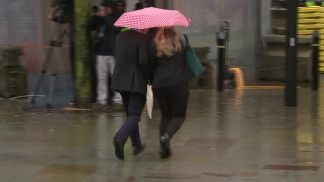 boris johnson determined to 'get brexit done' by end of october england manchester mid shot of building heavy rain falling on pavement two people... - mid adult stock videos & royalty-free footage