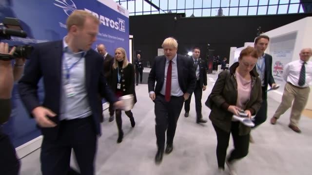 conservative party conference 2019: boris johnson has disposable coffee cup taken off him by aide; england: manchester: int boris johnson mp along... - slit och släng bildbanksvideor och videomaterial från bakom kulisserna