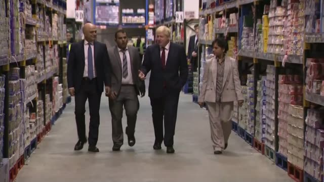 sajid javid announces plans for national living wage increase england manchester int boris johnson mp sajid javid mp and others along through cash... - standing stock videos & royalty-free footage