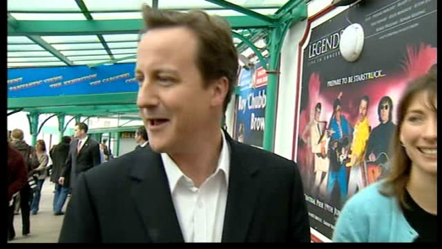 cameron calls for election england lancashire blackpool ext david cameron mp along sea front with his wife samantha cameron responds to reporter's... - politische partei stock-videos und b-roll-filmmaterial