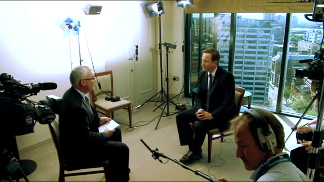 child benefit cuts david cameron apology birmingham int reporter interviewing cameron david cameron mp interview sot most londoners will think this... - financial accessory stock videos and b-roll footage