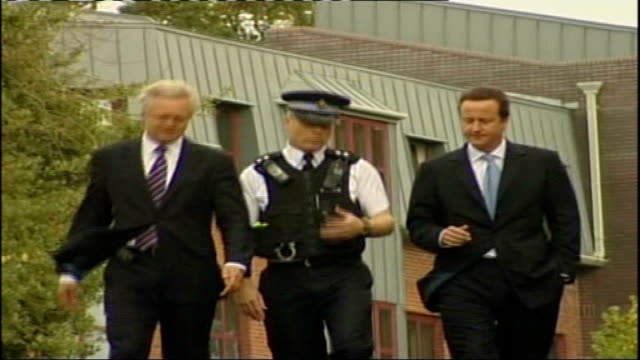 conservative party conference: david cameron and david davis visit dorset police headquarters; england: dorset: bournemouth: ext low angle shot of... - huw edwards stock videos & royalty-free footage
