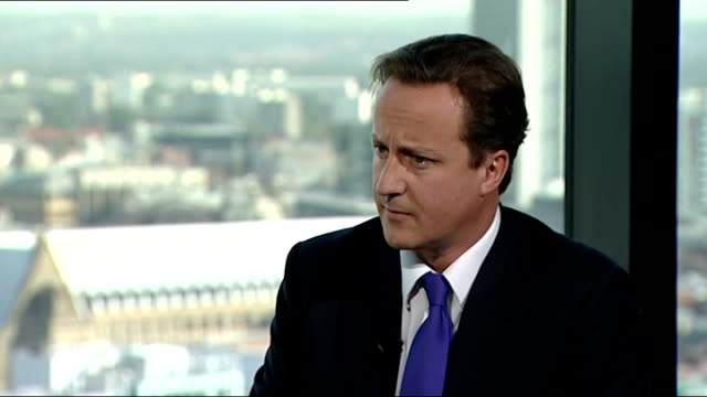 David Cameron interview David Cameron interview SOT It was a direct warning to the bankers if they decide to pay themselves big bonuses when they...