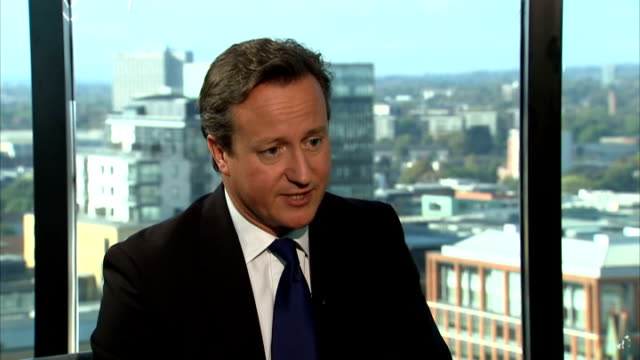 conservative party conference: david cameron interview; int 2 shot reporter and cameron q: is eliminating borrowing entirely unnecessary? david... - sun roof stock videos & royalty-free footage