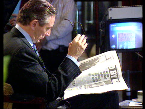 day 1 england lancashire blackpool sir norman fowler mp reading daily mirror with allegations about margaret thatcher's thoughts on john major cbv... - bbc video stock e b–roll