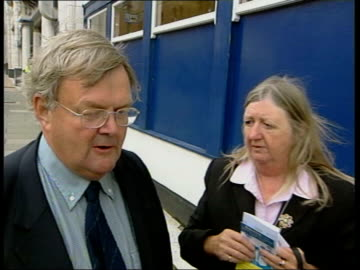 conservative party conference: day 1; itn england: blackpool: ext gv rough sea around pier sea with railings in f/g lifebuoy floating in sea int iain... - smith tower stock-videos und b-roll-filmmaterial