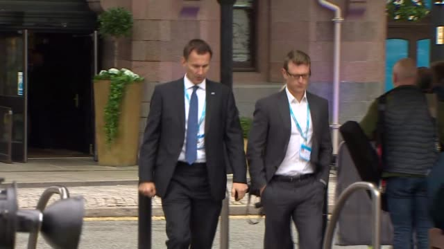 day 4 conservative mps and theresa may arrival england manchester ext chris grayling mp along / andrea leadsom mp arriving / jeremy hunt mp arriving... - andrea leadsom stock-videos und b-roll-filmmaterial