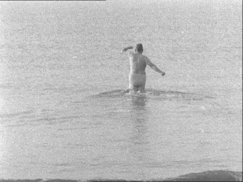 conservative party conference: day two: lord hailsham takes a morning swim; england: east sussex: brighton: ext lord hailsham along to seafront from... - wearing a towel stock videos & royalty-free footage