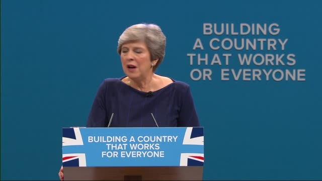 excerpt from Theresa May speech / letter 'F' falling down / May waving at end of speech ENGLAND Manchester INT Theresa May MP speech SOT coughing /...