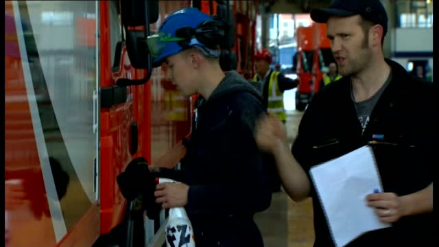 conservative party conference: george osborne mp visit to cartwright factory; england: manchester: int young men at work in factory, working on new... - warehouse点の映像素材/bロール