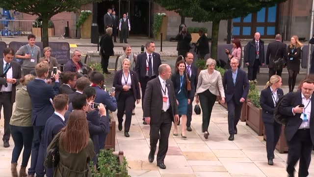 opening day theresa may attempts to brush off brexit divisions england manchester manchester central convention complex ext theresa may mp walks... - channel 4 news stock videos and b-roll footage