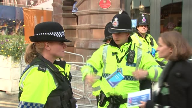 Antiausterity protests ENGLAND Manchester EXT Man dressed up with placard 'EU go to Hell' and banner / police officers and security guards on street...