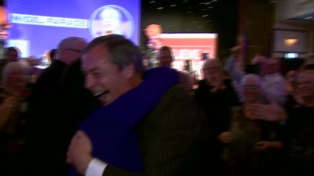Party continues to be divided over Brexit ENGLAND Solihull INT Nigel Farage MEP hugging woman as along to stage Farage on stage at 'Leave Means...