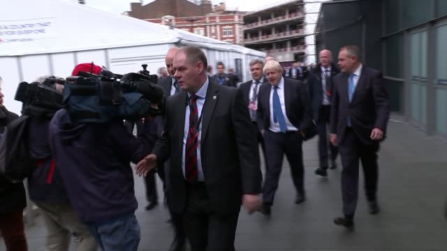 Philip Hammond attacks Corbyn in speech ENGLAND Manchester EXT Boris Johnson MP along as arriving at Conservative Party Conference Cameraman falls...