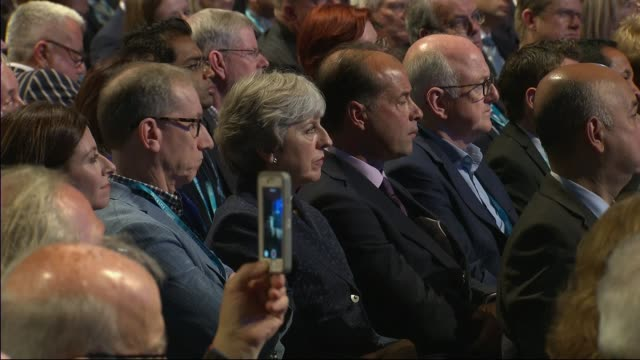 philip hammond attacks corbyn in speech cutaway theresa may mp and philip may in audience philip hammond during speech - husband stock videos & royalty-free footage