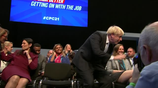 conservative party conference: rishi sunak speech; england: manchester: ext peter gibson mp interview sot cutways reporter questions sot set up shot... - simplicity stock videos & royalty-free footage