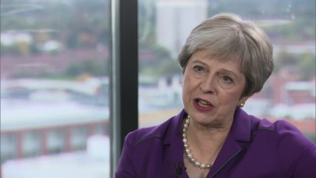 theresa may interview england birmingham int theresa may mp interview sot talks of new migration policy after brexit / committed to migration in the... - abundance stock videos & royalty-free footage
