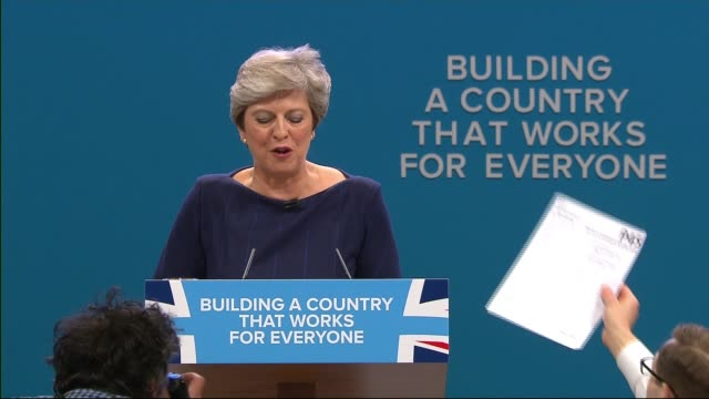 conservative party conference: theresa may speech; england: manchester: int delegates standing to applaud as prime minister theresa may mp takes to... - premierminister stock-videos und b-roll-filmmaterial