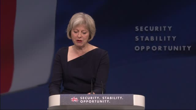 Theresa May speech on immigration INT Theresa May along on stage to applause at Tory Party Conference SOT Theresa May MP speech SOT While we must...