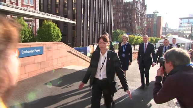 Theresa May speech on immigration ENGLAND Manchester Manchester Central Convention Complex EXT Theresa May MP along with aides towards Conservative...