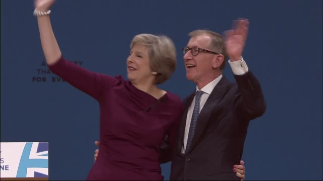 theresa may speech ****some various of may embraced on stage by her husband philip and both on stage waving to audience various of theresa and philip... - husband stock videos & royalty-free footage
