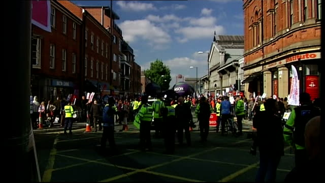 vídeos y material grabado en eventos de stock de union protests against nhs cuts england manchester liverpool road ext various shots of union demonstrators gathered in street ahead of march many... - satírico