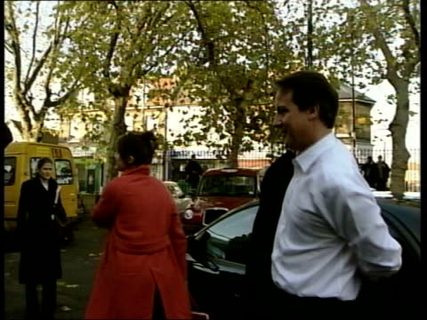 david cameron first day as leader itn england london david cameron mp from car not wearing a tie and putting on jacket pan as greeted int tms side... - デビッド・キャメロン点の映像素材/bロール