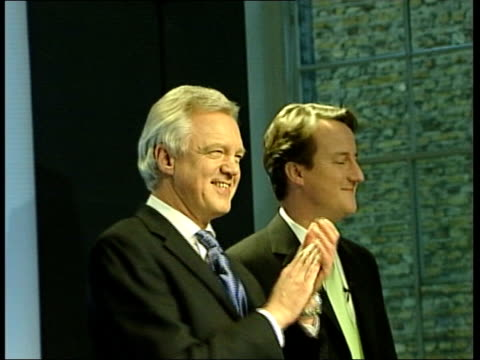 vídeos y material grabado en eventos de stock de david cameron wins leadership race itn david davis mp on stage with cameron during announcement of results ballot results as turns to shake camerons... - partido conservador británico