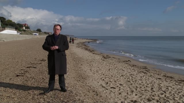 conservative party election expenses investigation: clacton party workers demand action; waves breaking on the beach various of clacton pier waves... - vh1ビッグインアワード点の映像素材/bロール