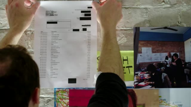vídeos de stock e filmes b-roll de conservative party election expenses scandal: 12 mps face criminal charges; int conservative poster pinned to map on white wall election campaign... - partido conservador britânico
