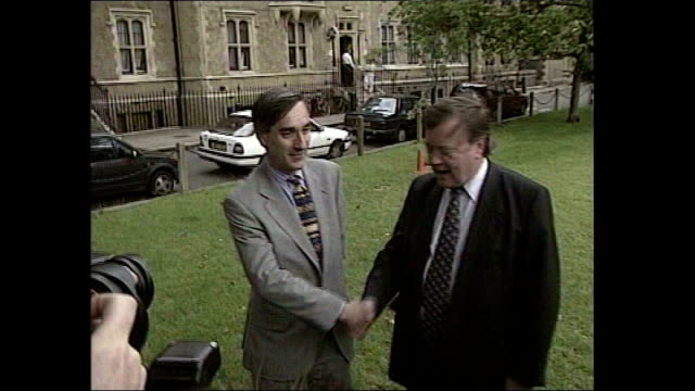 ken clarke appointed shadow business secretary tx london ext clarke shaking hands with john redwood at photocall - 政治家 ケネス・クラーク点の映像素材/bロール