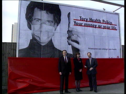 "conservative party launches ""double whammy"" attack on labour; tx 17.2.92 lagv labour poster ""nhs : your money or your life"" cms health secretary... - scalpel stock videos & royalty-free footage"