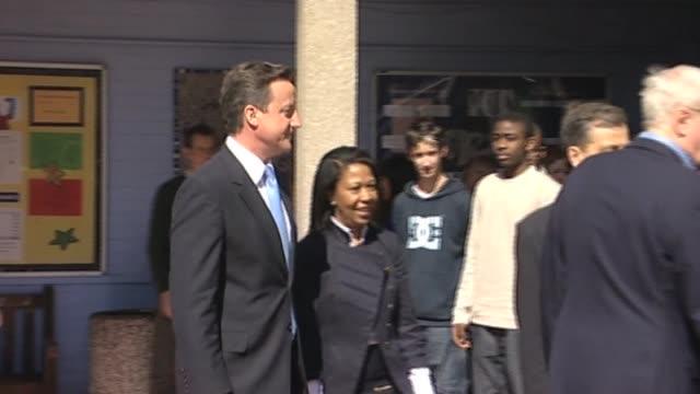 vídeos de stock e filmes b-roll de conservative party leader david cameron and actor michael caine visit youth centre during election campaign london 8 april 2010 - michael caine ator