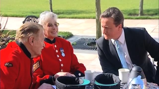 stockvideo's en b-roll-footage met conservative party leader david cameron chats to chelsea pensioners at royal hospital chelsea london 9 april - number 9