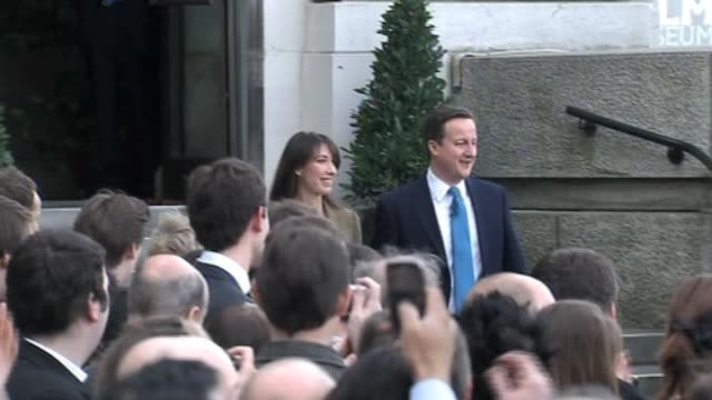 conservative party leader david cameron walks on stage with wife samantha then addresses crowds and press following news of general election on 6 may... - 2010 個影片檔及 b 捲影像