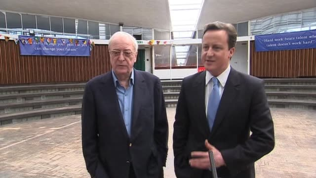 vídeos de stock e filmes b-roll de conservative party leader david cameron with actor sir michael caine discussing proposed national citizen service london 8 april 2010 - michael caine ator
