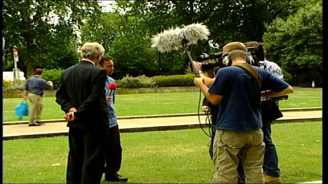 leadership contenders address mps; itn england: london: westminster: ext gvs david davis walking along & up to press, gvs davis talking to press,... - david m. davis politician stock videos & royalty-free footage