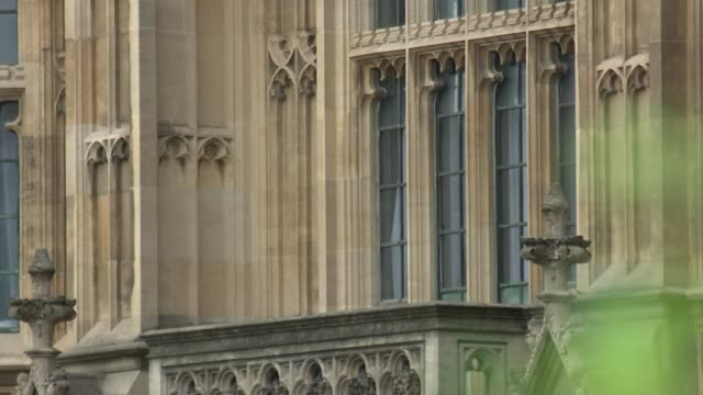 1922 committee may limit number of candidates england london westminster ext close shots of windows of houses of parliament nigel evans mp interview... - staatsdienst stock-videos und b-roll-filmmaterial