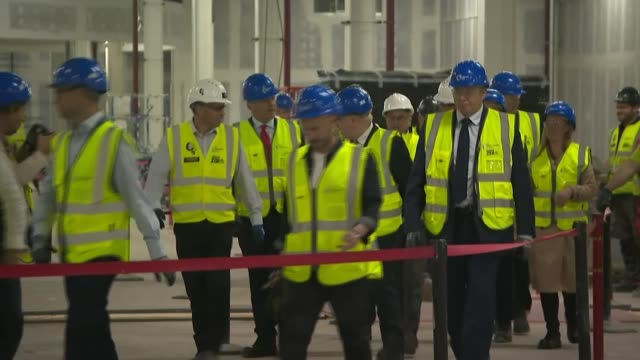 boris johnson visits manchester airport england greater manchester ringway manchester airport boris johnson chatting as along with others on a... - construction site stock videos & royalty-free footage