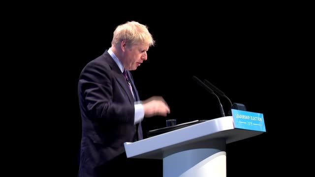 candidates face questions from members in birmingham hustings england birmingham int boris johnson mp speech sot part 2 of 2 / cutaways of audience - midlands occidentali video stock e b–roll