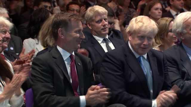 cutuways of result announcement and boris johnson speech england london qeii conference centre int audience gathered for the announcement of the... - boris johnson stock videos & royalty-free footage