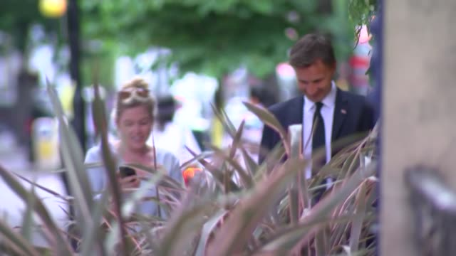 Jeremy Hunt arrives in Sloane Square ENGLAND London Sloane Square EXT Jeremy Hunt MP arriving with advisors and his wife Lucia Hunt / Jeremy Hunt...