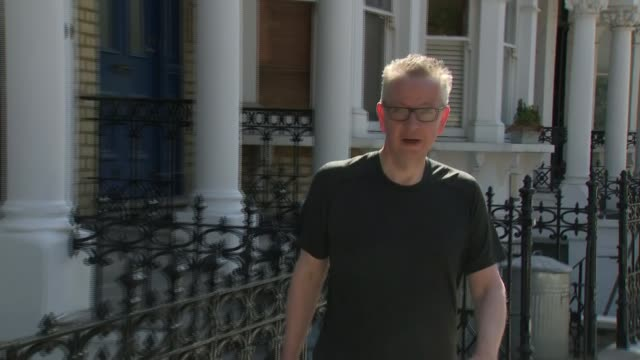 michael gove doorstep jogging england london ext michael gove mp jogs along street and enters house ignoring reporter's question about donald trump... - running stock videos & royalty-free footage