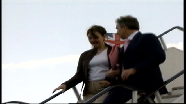 electoral commission demands more details heathrow airport low angle tony blair mp and wife cherie blair down steps of plane on arrival back from... - キャシー・ニューマン点の映像素材/bロール