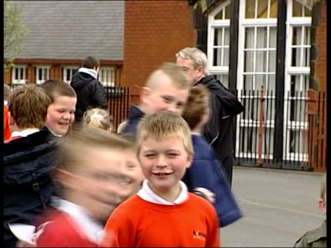 conservative party manifesto launched:; england lancashire darwen ext seq primary school children along to school with parents vox pops voters on... - top of the pops stock videos & royalty-free footage